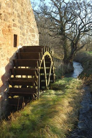 water mill: the Old Mill wheel and stream at East Linton in East Lothian, Scotland