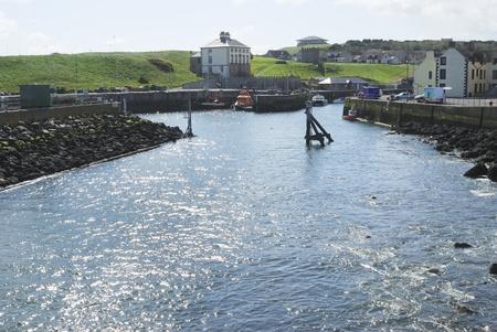 glistening: sunlight glistening on water in harbour at Eyemouth, Berwickshire