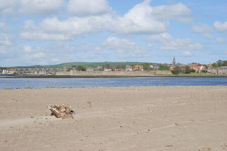 sandbank: looking over the Tweed estuary to Berwick-upon-Tweed medieval city walls,bridges and river, spire and sandbank Stock Photo