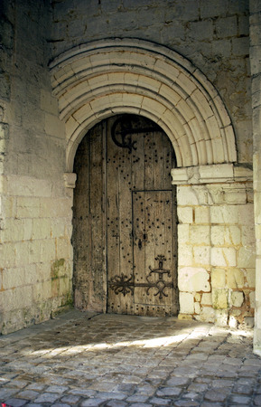 ironwork: historical arched door at Fontevraud church, France Stock Photo