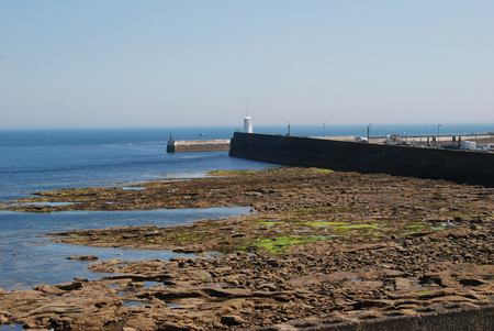 harbour wall and entrance at Seahouses Northumberland Stock Photo
