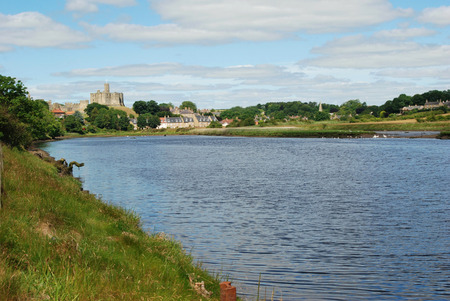 riverbank: Warkworth castle and Wark on the river Aln near Alnwick