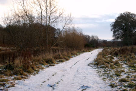 pathway along river Tweed in early winters morning