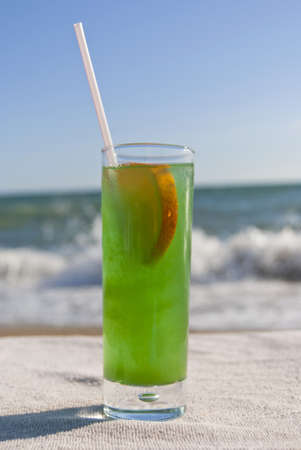 Green cocktail on the beach photo