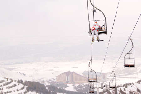 Beautiful skier lift up on chairlift in Palandoken photo