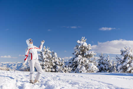 cheery: Cheery skier on the top of mountain Stock Photo