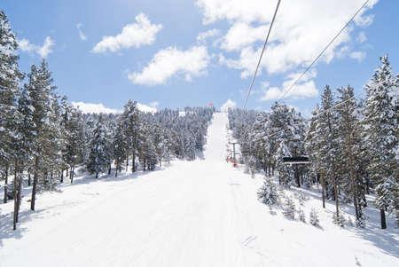 View on black ski-route near chairlift in Sarikamis. Turkey Stock Photo