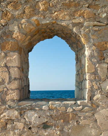 View on the sea from fortress window Stock Photo