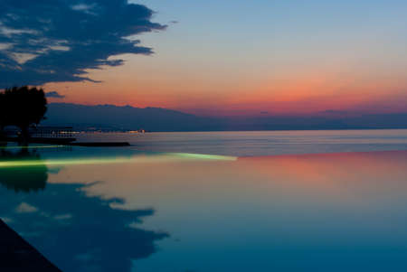 Infinity pool on the beach in luxury hotel at sunset. Crete. Greece Stock Photo - 11562018