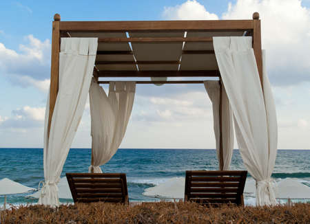 Pavilion for relax on the beach in resort. Early morning. photo
