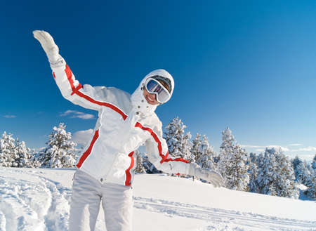 Happy playful woman skier fly on the top of mountain