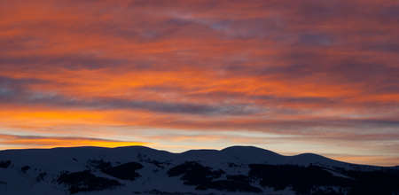 View of snowy mountain on sunrise in early morning Stock Photo