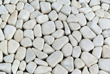 Background with a pattern and texture of ground grey pebbles  photo