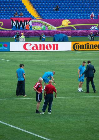 KHARKOV, UKRAINE - JUNE 9, 2012: Netherlands national football team tests pitch before match with Denmark on June 9, 2012 in Kharkov.