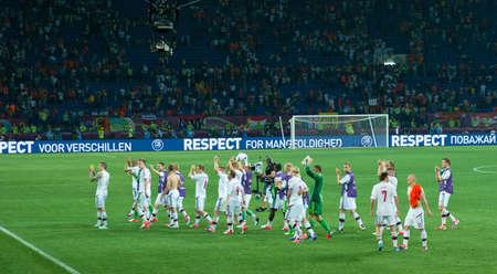 KHARKOV, UKRAINE - JUNE 9, 2012: Denmark national football team thanks fans after match with Netherlands on June 9, 2012 in Kharkov. Editorial