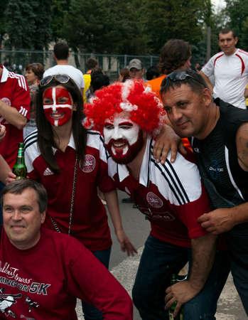 KHARKOV, UKRAINE - JUNE 9: Denmark fans pose near stadium before match on June 9, 2012 in Kharkov. Editorial