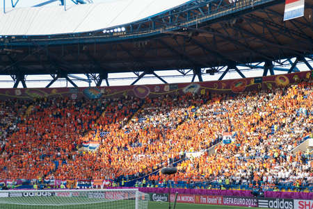 KHARKOV, UKRAINE - JUNE 9: Netherlands fans on stadium before beginning of match on June 9, 2012 in Kharkov.
