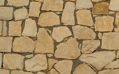 Decorate sandstone wall surface. Texture background Stock Photo
