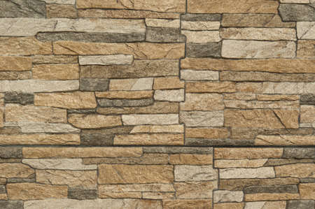 Modern pattern of stone wall decorative surfaces. Texture background photo
