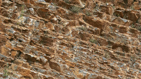 Natural cracked stone texture closeup background Stock Photo