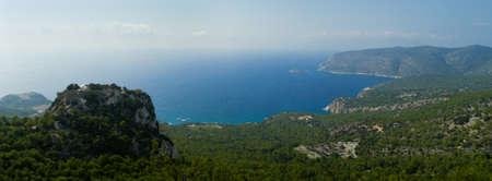 panteleimon: Venetian castle of Monolithos on top of a mountain. Agios Georgios bay. Rhodes, Greece, Europe  Stock Photo