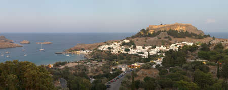 Lindos acropolis in the evening with lights on the town houses and acropolis. Rhodes. Greece
