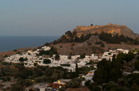 Lindos acropolis in the evening with lights. Rhodes. Greece  Stock Photo