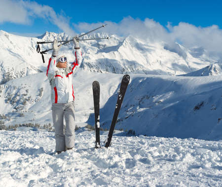 Smiling skier posing on the top of mountain Pirin. Bansko. Bulgaria Stock Photo