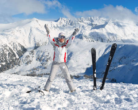 Cheerful skier on the top of Pirin mountains. Bansko. Bulgaria Stock Photo