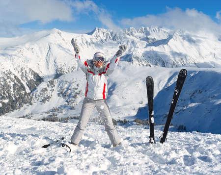 Cheerful skier on the top of Pirin mountains. Bansko. Bulgaria Stock Photo