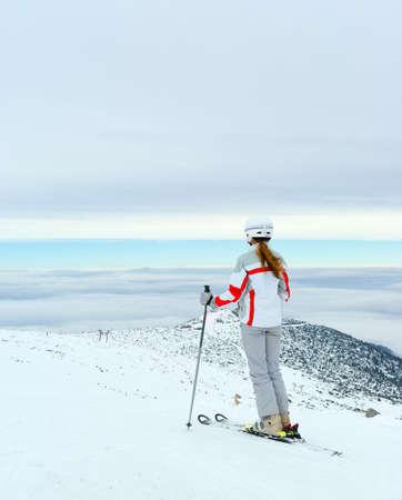 Skier admire on beautiful view from top of Pirin mountains. Bansko. Bulgaria. Stock Photo