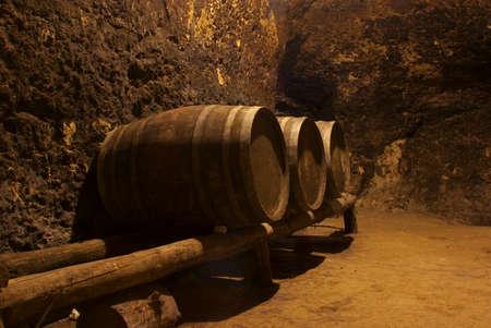 Row of wine wooden tuns underground in bulgarian winery photo