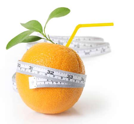 slim tummy: orange with measuring isolated on white background