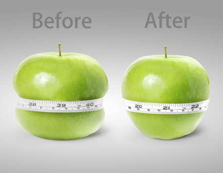 白い背景の上の測定とグリーンアップル