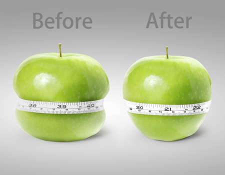 Green apple with measurement on a white background Stock Photo