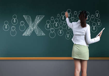 Business woman showing Social Network Concept on Blackboard