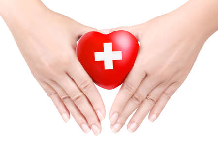 elementos de protecci�n personal: Coraz�n en las manos en blanco Foto de archivo