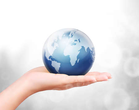 environmental pollution: Globe ,earth in human hand against