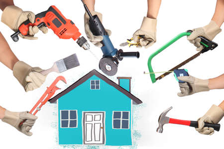 home repair: Selection of tools in the shape of a house, home improvement concept