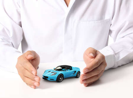auto leasing: businessmen hands holding car  Stock Photo