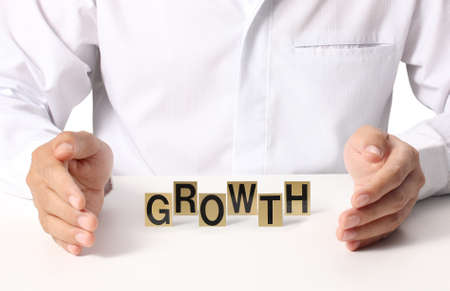 word growth in hand, businessman