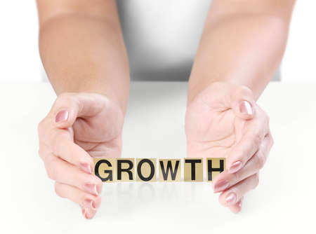 Hand and word growth on white background photo