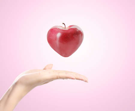 heart apple in a hand Stock Photo - 15399983