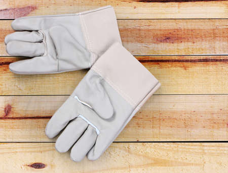 Gloves on the wood background photo