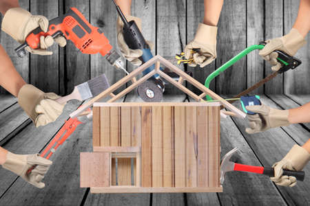 power: Selection of tools in the shape of a house, home improvement concept