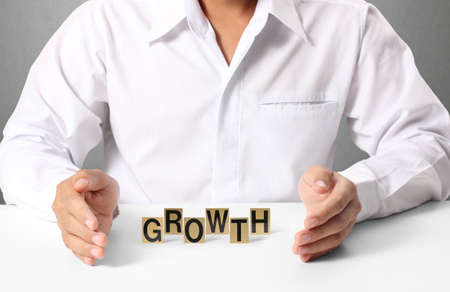 word growth in hand, businessman  photo