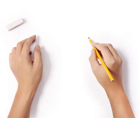 何かを書く鉛筆と消去のゴムと手