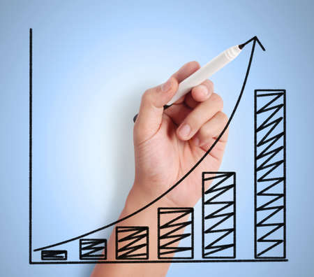 Business man drawing a graph Stock Photo - 16326579