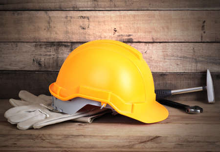 Yellow hardhat and old leather gloves Stock Photo - 16542605