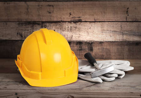 Yellow hardhat and old leather gloves  Stock Photo - 16856866